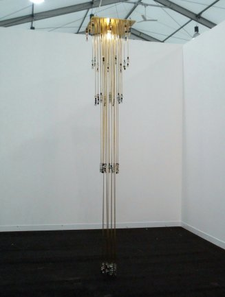 Maria Loboda, The sentence in its temporary form as glass and pumice, 2012. Brass, glass and pumice stone. 295 x 50 x 50 cm